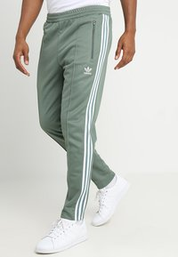 adidas Originals - BECKENBAUER - Tracksuit bottoms - trace green - 0