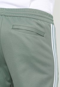 adidas Originals - BECKENBAUER - Tracksuit bottoms - trace green - 5