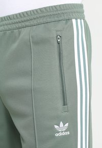 adidas Originals - BECKENBAUER - Tracksuit bottoms - trace green - 3