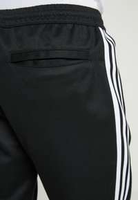 adidas Originals - BECKENBAUER - Tracksuit bottoms - black - 3