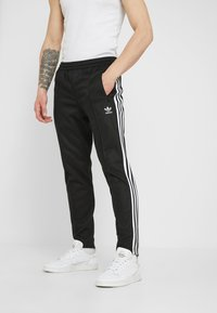 adidas Originals - BECKENBAUER - Tracksuit bottoms - black - 0