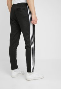 adidas Originals - BECKENBAUER - Tracksuit bottoms - black - 2