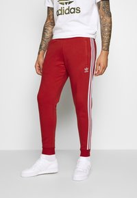 adidas Originals - STRIPES PANT - Teplákové kalhoty - lush red - 0