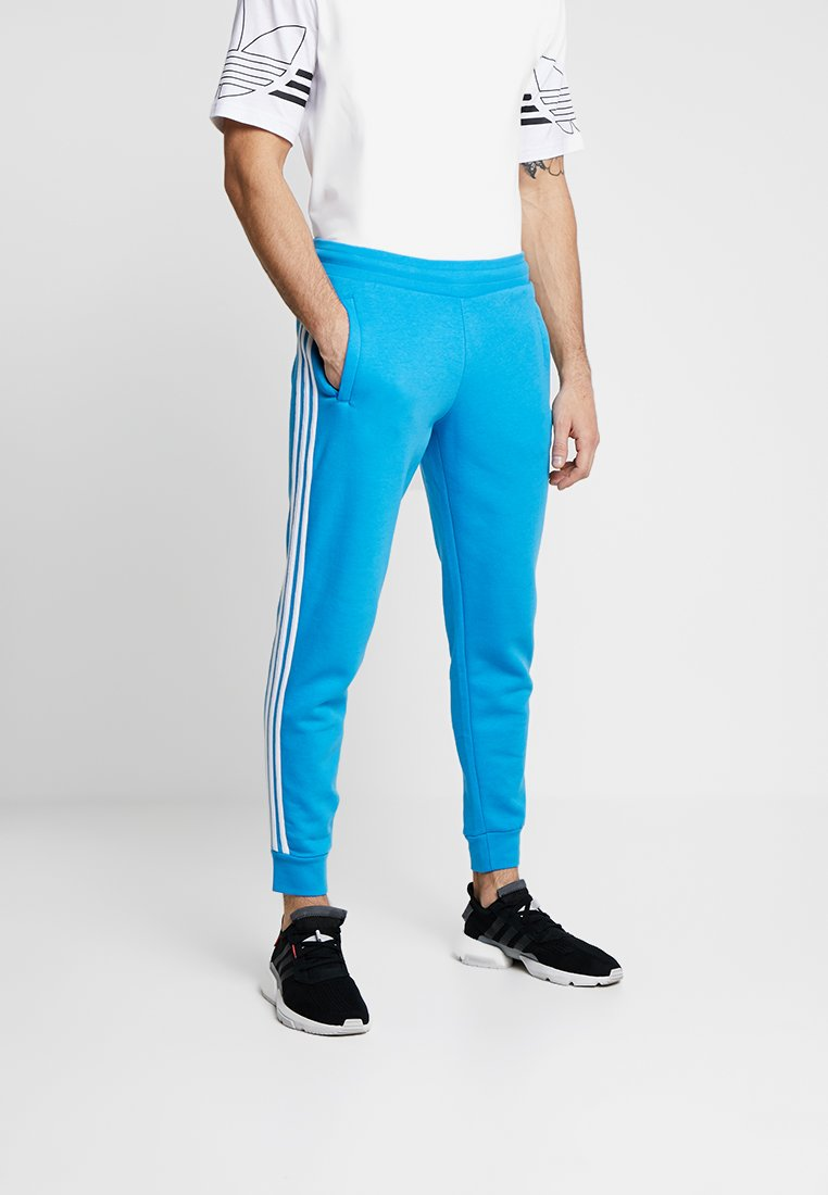 adidas Originals - STRIPES PANT - Tracksuit bottoms - light blue