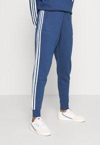 adidas Originals - STRIPES PANT - Trainingsbroek - nmarin - 3