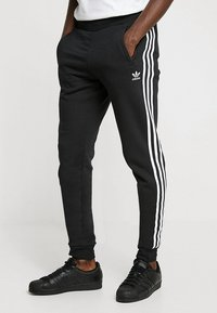 adidas Originals - STRIPES PANT - Verryttelyhousut - black - 0