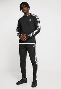 adidas Originals - STRIPES PANT - Tracksuit bottoms - black - 1
