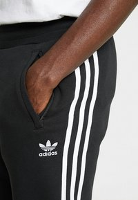 adidas Originals - STRIPES PANT - Verryttelyhousut - black - 3