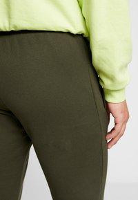 adidas Originals - ADICOLOR REGULAR TRACK PANTS - Pantalon de survêtement - night cargo - 3
