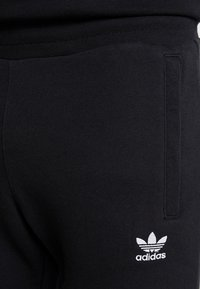 adidas Originals - ADICOLOR REGULAR TRACK PANTS - Jogginghose - black - 4