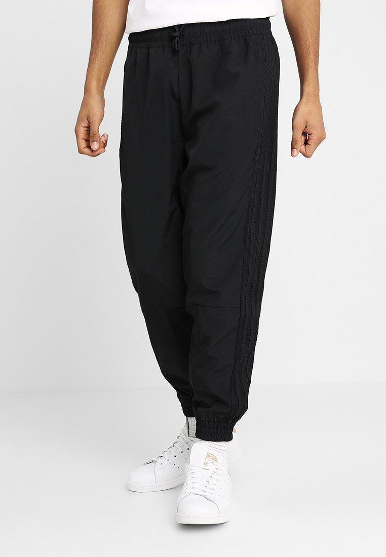 adidas Originals - TRACKPANTS - Pantalon de survêtement - black