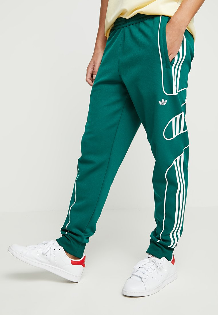 adidas Originals - FLAMESTRK - Tracksuit bottoms - green