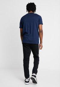 adidas Originals - OUTLINE REGULAR TRACK PANTS - Tracksuit bottoms - black - 2