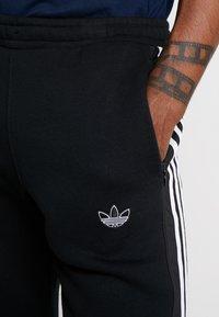 adidas Originals - OUTLINE REGULAR TRACK PANTS - Tracksuit bottoms - black - 5