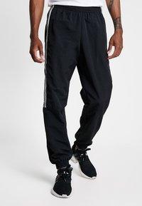 adidas Originals - LOCK UP - Tracksuit bottoms - black - 0