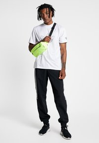 adidas Originals - LOCK UP - Tracksuit bottoms - black - 1