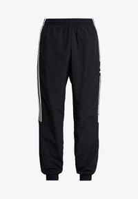 adidas Originals - LOCK UP - Tracksuit bottoms - black - 4