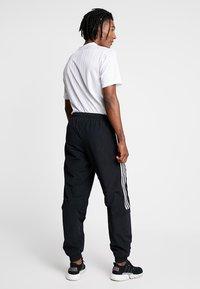 adidas Originals - LOCK UP - Tracksuit bottoms - black - 2