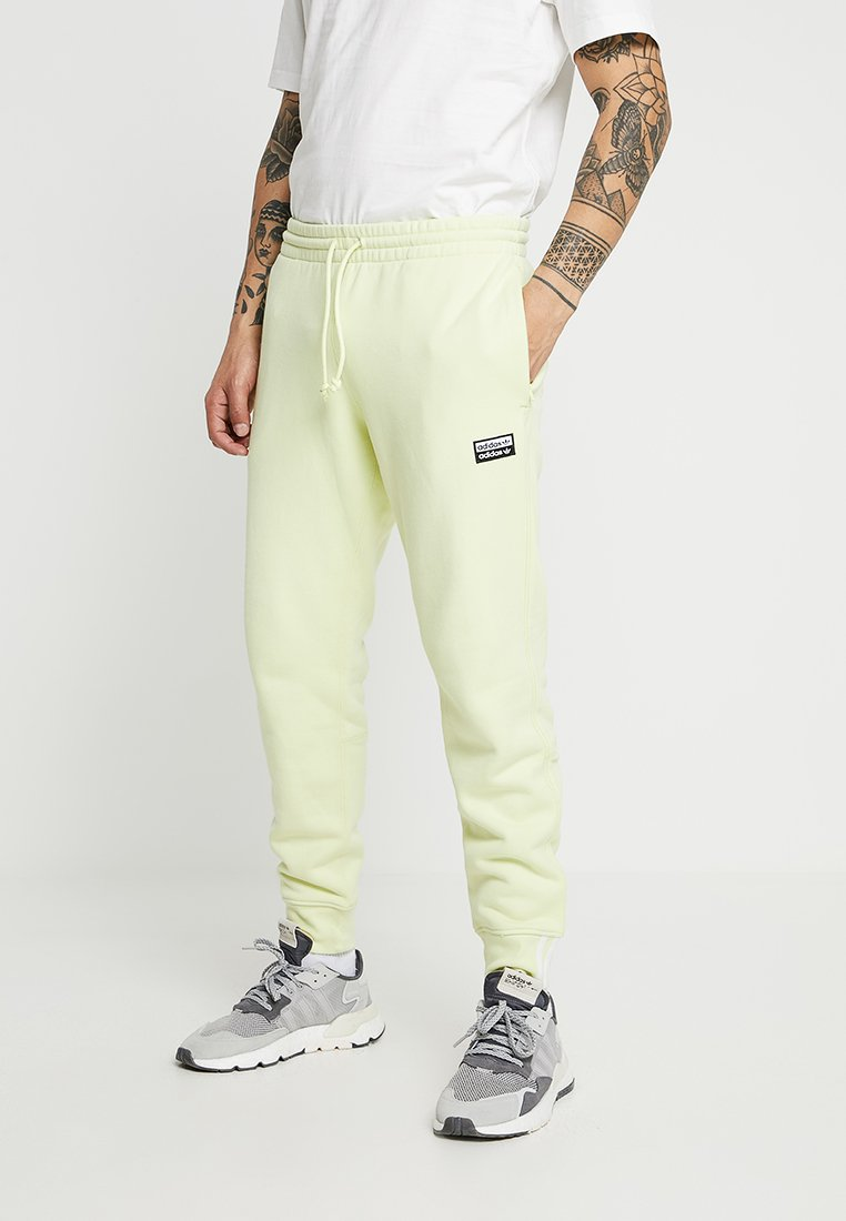 adidas Originals - REVEAL YOUR VOICE - Tracksuit bottoms - ice yellow