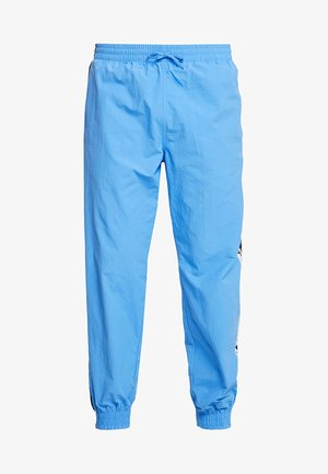 REVEAL YOUR VOICE - Tracksuit bottoms - real blue