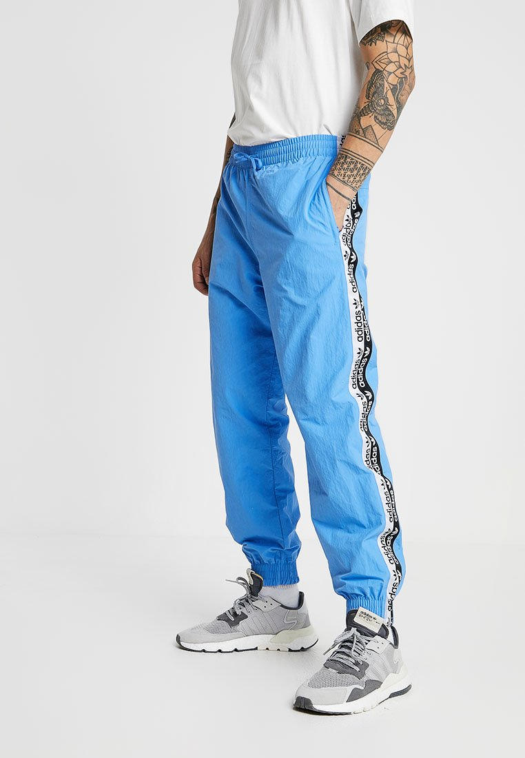 adidas Originals - REVEAL YOUR VOICE - Tracksuit bottoms - real blue