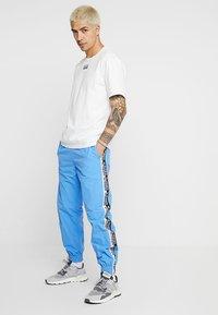 adidas Originals - REVEAL YOUR VOICE - Trainingsbroek - real blue - 1