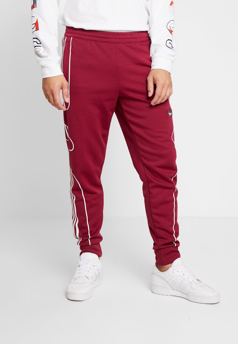 adidas Originals - OUTLINE STRIKE REGULAR TRACK PANTS - Tracksuit bottoms - mystery ruby
