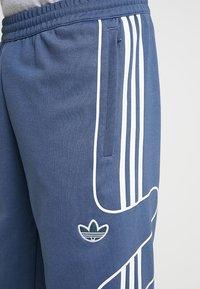 adidas Originals - OUTLINE STRIKE REGULAR TRACK PANTS - Trainingsbroek - tech ink - 4