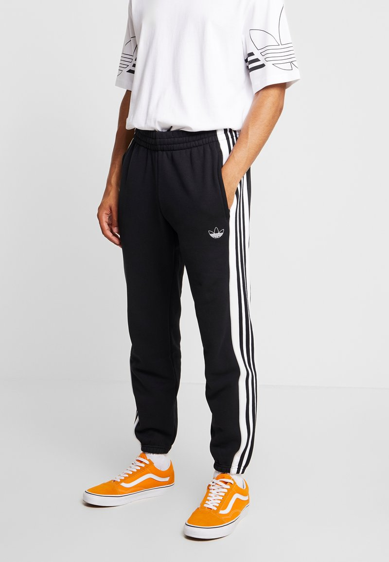 adidas Originals - STRIPE PANEL - Pantalones deportivos - black/white