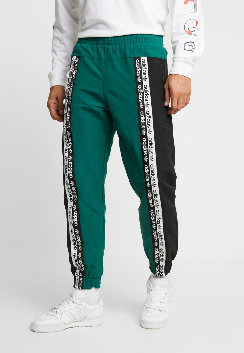 adidas Originals - REVEAL YOUR VOICE TRACKPANT - Tracksuit bottoms - collegiate green