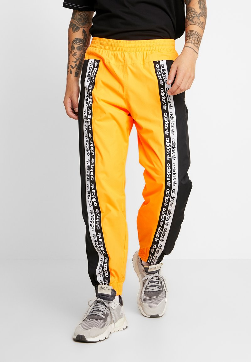 adidas Originals - REVEAL YOUR VOICE TRACKPANT - Tracksuit bottoms - flash orange