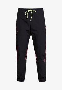 adidas Originals - REGULAR TRACK PANTS - Pantalon cargo - black - 4