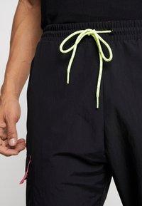 adidas Originals - REGULAR TRACK PANTS - Pantalon cargo - black - 3
