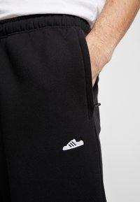 adidas Originals - Tracksuit bottoms - black - 5