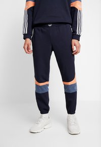 adidas Originals - Tracksuit bottoms - legend ink/easy orange - 0