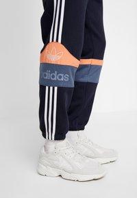 adidas Originals - Tracksuit bottoms - legend ink/easy orange - 4