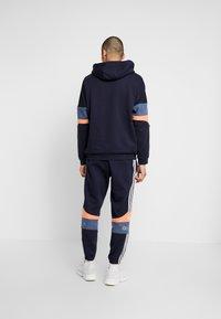 adidas Originals - Tracksuit bottoms - legend ink/easy orange - 2