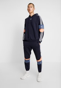 adidas Originals - Tracksuit bottoms - legend ink/easy orange - 1
