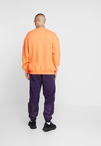 adidas Originals - REVEAL YOUR VOICE TREFOIL TRACKPANT - Joggebukse - legend purple - 2
