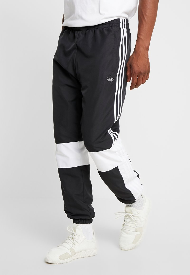 adidas Originals - TRACK PANT - Tracksuit bottoms - black/white