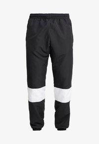 adidas Originals - TRACK PANT - Pantalon de survêtement - black/white - 3