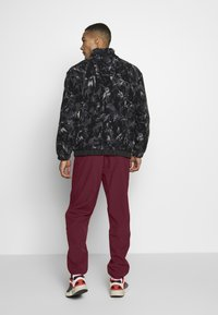 adidas Originals - WINTERIZED TRACK PANT - Trainingsbroek - coll burgundy/bold pink - 2