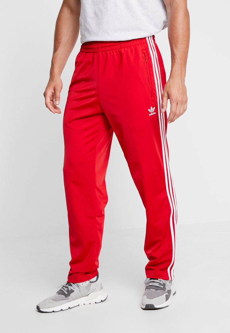 adidas Originals - FIREBIRD  - Tracksuit bottoms - scarlet