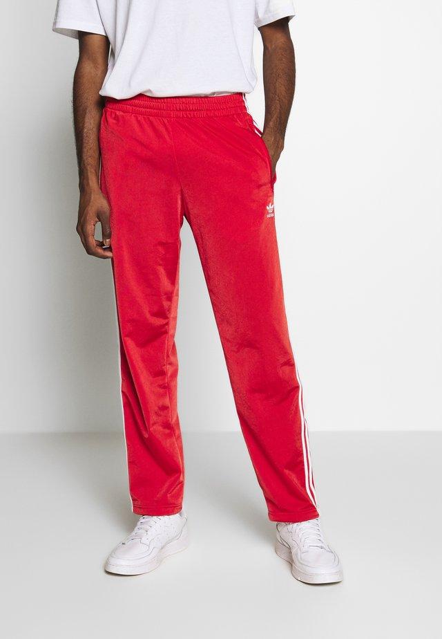 FIREBIRD ADICOLOR TRACK PANTS - Pantaloni sportivi - lush red