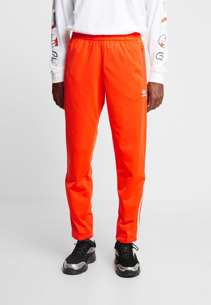 adidas Originals - FIREBIRD  - Tracksuit bottoms - orange