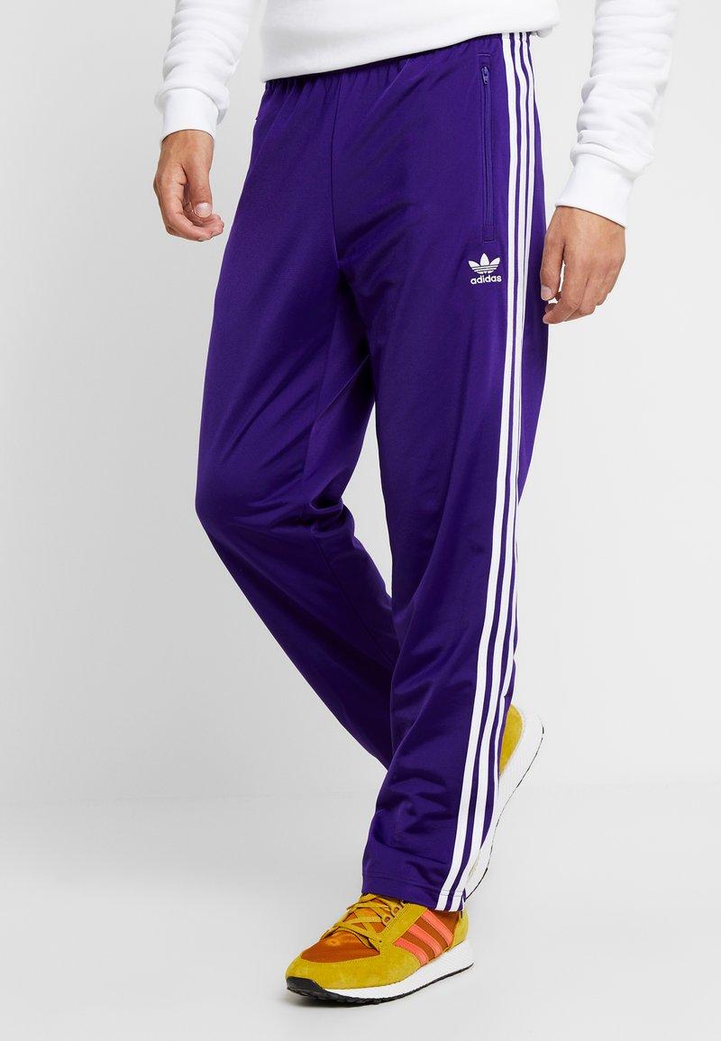 adidas Originals - FIREBIRD  - Tracksuit bottoms - collegiate purple