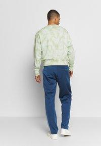 adidas Originals - FIREBIRD ADICOLOR TRACK PANTS - Tracksuit bottoms - marine - 2