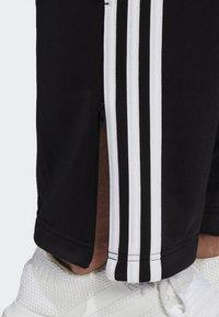 adidas Originals - FIREBIRD ADICOLOR TRACK PANTS - Spodnie treningowe - black - 4