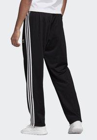 adidas Originals - FIREBIRD ADICOLOR TRACK PANTS - Spodnie treningowe - black - 1
