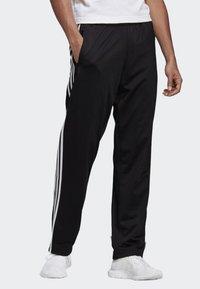 adidas Originals - FIREBIRD ADICOLOR TRACK PANTS - Spodnie treningowe - black - 0